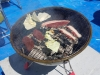 エゾシカ肉を炭火で焼いている所その1